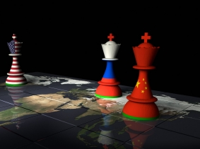 World map with chess pieces with flags of Russia, China, and the United States, photo by theasis/Getty Images