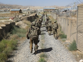 U.S. military advisers from the 1st Security Force Assistance Brigade walk at an Afghan National Army base in Maidan Wardak province, Afghanistan, August 6, 2018, photo by James Mackenzie/Reuters