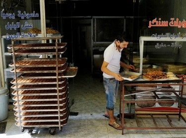A Syrian refugee man works at a bakery in Gaziantep, Turkey, May 16, 2016, photo by Umit Bektas/Reuters