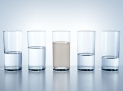 Five glasses of water, with dirty water in the center, photo by hdere/Getty Images