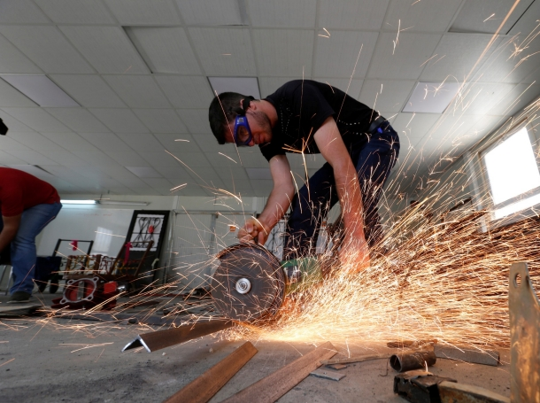 Syrian refugee metal shop trainees work at one of the vocational training centres near Al Azraq city, Jordan, June 27, 2016