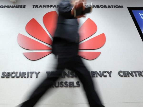 A man visits the Huawei Cyber Security Transparency Centre in Brussels, Belgium, March 5, 2019, photo by Yves Herman/Reuters