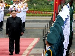 North Korea's leader Kim Jong Un and Vietnam's President Nguyen Phu Trong review an honor guard during a welcome ceremony in Hanoi, Vietnam, March 1, 2019, photo by Luong Thai Linh/Reuters