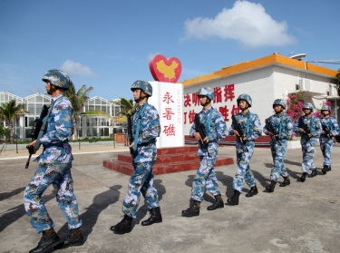 Soldiers of China's People's Liberation Army Navy patrol at Fiery Cross Reef, in the Spratly Islands, February 9, 2016, photo by China Stringer Network/Reuters