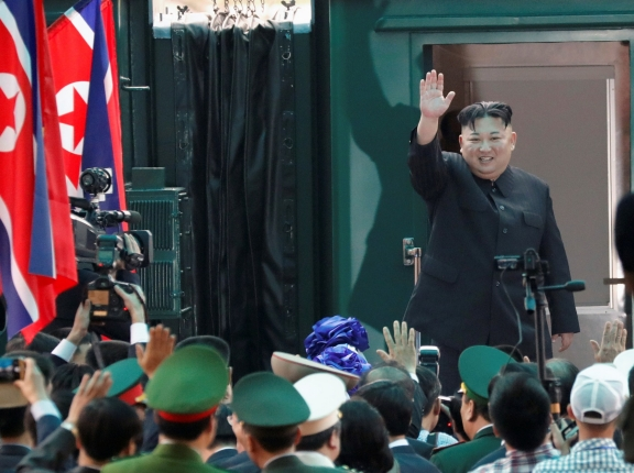 North Korean leader Kim Jong Un bids farewell before boarding his train to depart for North Korea at Dong Dang railway station in Vietnam, March 2, 2019, photo by Kim Kyung-Hoon/Reuters