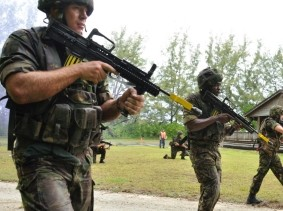 British Royal Marine commandos participate in a hostile scenario during exercise at Diego Garcia, British Indian Ocean Territory, April 12, 2012, photo by Mass Communication Specialist 3rd Class April D. Adams/U.S. Navy