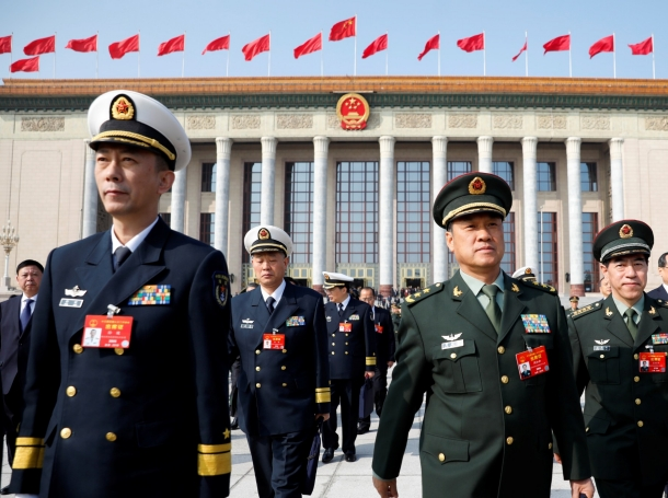 Military delegates leave the Great Hall of the People after a meeting ahead of National People's Congress in Beijing, China, March 4, 2019, photo by Aly Song/Reuters