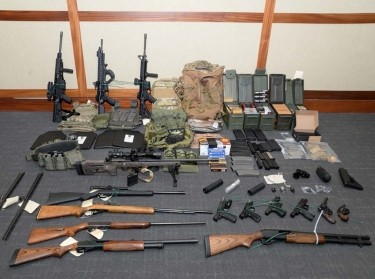 A cache of guns and ammunition uncovered by U.S. federal investigators in the home of U.S. Coast Guard lieutenant Christopher Paul Hasson in Silver Spring, Maryland, February 20, 2019, photo by U.S. Attorney's Office Maryland/Reuters