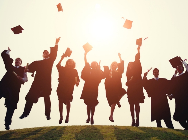 College students in silhouette tossing caps in the air, photo by Rawpixel Ltd/Getty Images
