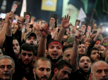 Supporters of Lebanon's Hezbollah leader holding pictures of Iran's supreme leader Ayatollah Ali Khamenei in Beirut, Lebanon, October 11, 2016, photo by Aziz Taher/Reuters