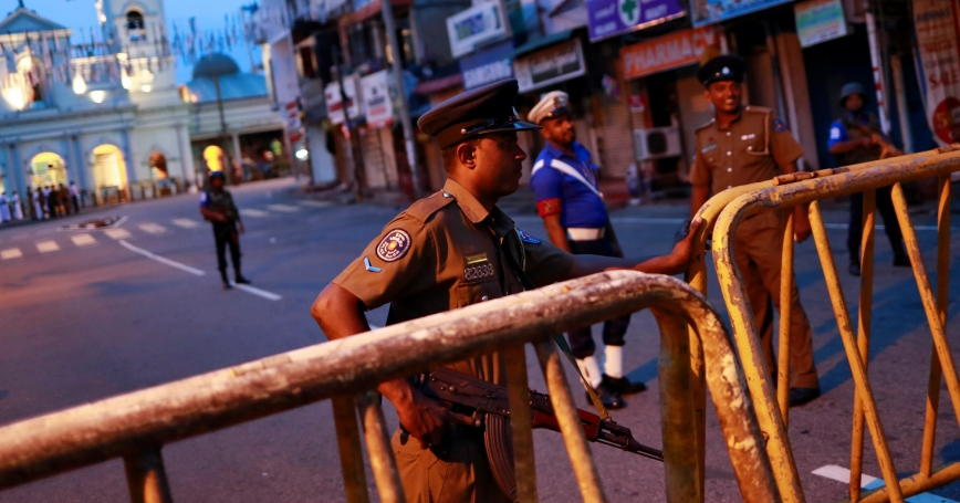Security personnel stand guard in front of St. Anthony's Shrine, days after a string of suicide bomb attacks across the island on Easter Sunday, in Colombo, Sri Lanka, April 29, 2019, photo by Danish Siddiqui/Reuters