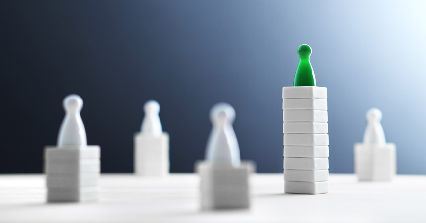 Game pieces on stacks of varying height, photo by Tero Vesalainen/Getty Images