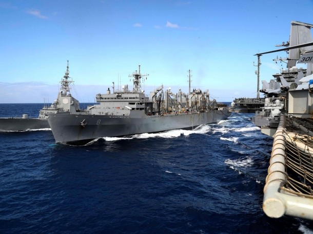 The aircraft carrier USS Abraham Lincoln conducts a replenishment-at-sea operation with other carrier group ships. The carrier group is now in the Red Sea earlier than planned at the direction of the White House, photo by Mass Communication Specialist 3rd Class Jeff Sherman/U.S. Navy photo