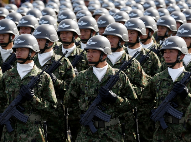 Members of Japan's Self-Defence Forces' airborne troops stand at attention during the annual SDF ceremony at Asaka Base, Japan, October 23, 2016, photo by Kim Kyung Hoon/Reuters