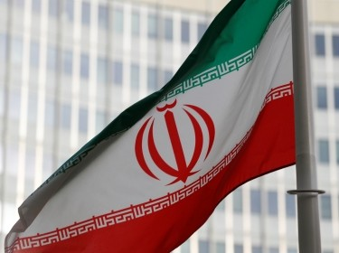The Iranian flag flutters in front the International Atomic Energy Agency (IAEA) headquarters in Vienna, Austria, March 4, 2019, photo by Leonhard Foeger/Reuters