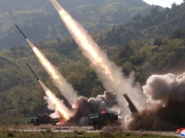 Missiles being launched during a military drill in North Korea, May 10, 2019, photo by KCNA/Reuters