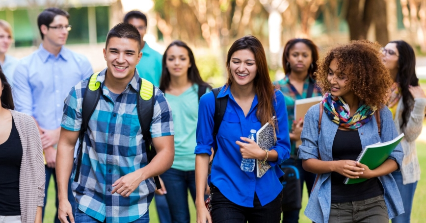 High school and college students walking together, photo by Steve Debenport/Getty Images