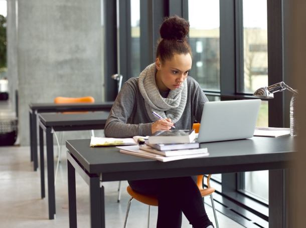 College student using a laptop, photo by jacoblund/Getty Images