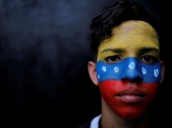 A protester poses for a portrait during a rally against Venezuelan President Nicolas Maduro's government in Caracas, February 2, 2019, photo by Carlos Barria/Reuters