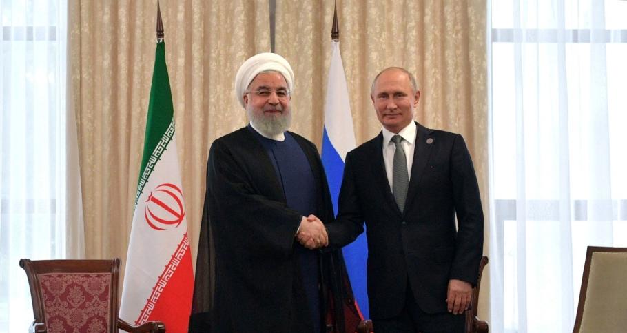 Iranian President Hassan Rouhani and Russian President Vladimir Putin at the Shanghai Cooperation Organisation summit in Bishkek, Kyrgyzstan, June 14, 2019