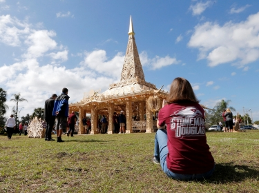 A guest looks at the Temple of Time, a structure built to serve as a healing place for those affected by the shooting which claimed 17 lives at nearby Marjory Stoneman Douglas High School in Coral Springs, Florida, February 14, 2019, photo by Joe Skipper/Reuters