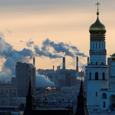 Steam rises from the chimneys of a thermal power plant behind the Ivan the Great Bell Tower in Moscow, Russia January 9, 2018, photo by Maxim Shemetov/Reuters