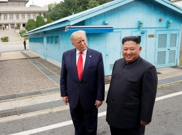 U.S. President Donald Trump meets with North Korean leader Kim Jong Un at the demilitarized zone (DMZ) that separates the two Koreas, Panmunjom, South Korea, June 30, 2019, photo by Kevin Lamarque/Reuters