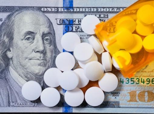 White prescription pills on a U.S. $100 bill