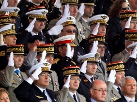 French army officers salute during the traditional Bastille Day military parade in Paris July 14, 2012, photo by Charles Platiau/Reuters