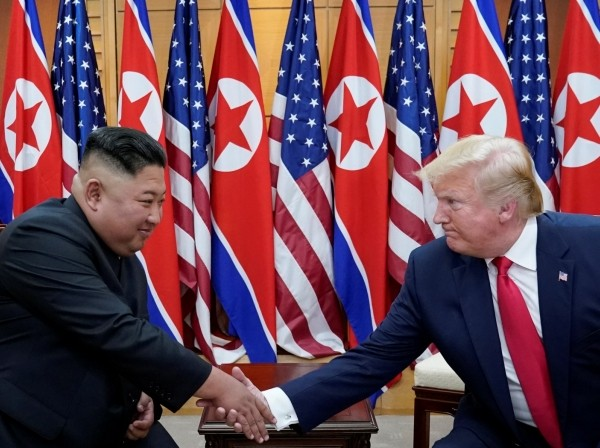 U.S. President Donald Trump meets with North Korean leader Kim Jong Un at the demilitarized zone on the border of North and South Korea, June 30, 2019, photo by Kevin Lamarque/Reuters