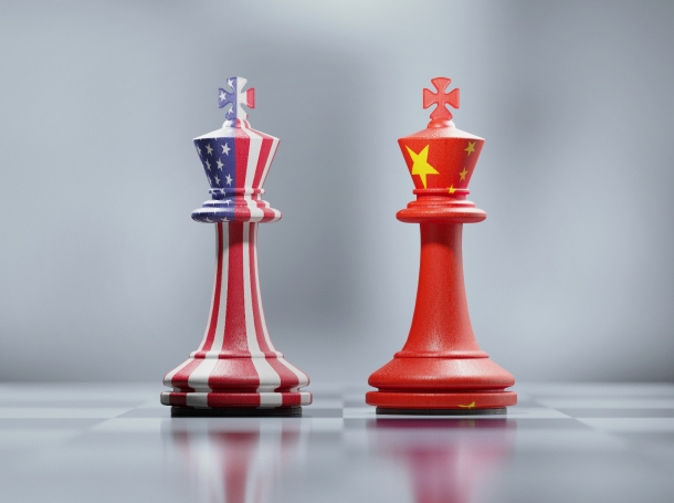 Two king chess pieces with United States and China flags, photo by MicroStockHub/Getty Images