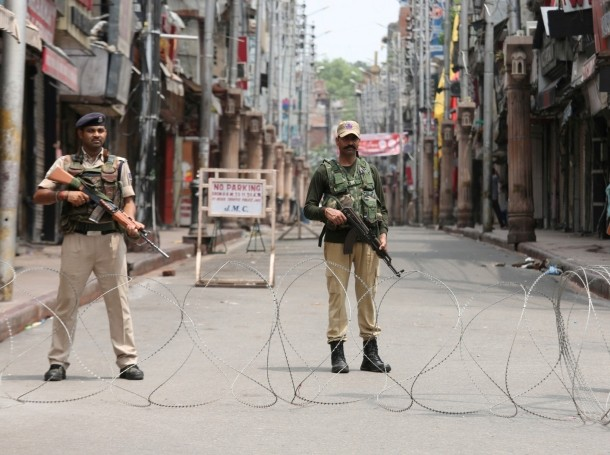 Indian security personnel stand guard along a deserted street during restrictions in Jammu, August 5, 2019, photo by Mukesh Gupta/Reuters