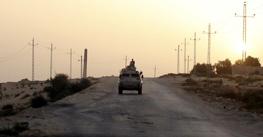 An Egyptian military vehicle on the highway in northern Sinai, Egypt, May 25, 2015, photo by Asmaa Waguih/Reuters