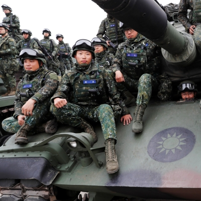 Soldiers sit on an M60A3 tank for a group photograph after an anti-invasion drill to test readiness ahead of Lunar New Year, simulating enemy invasion and the safeguarding of the weapon systems in case of air raid, in Taichung, Taiwan, January 17, 2019, Photo by Tyrone Siu/Reuters