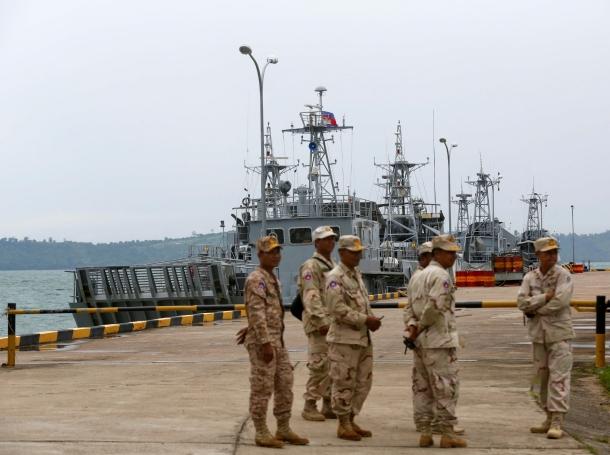 Sailors stand guard near petrol boats at the Cambodian Ream Naval Base in Sihanoukville, Cambodia, July 26, 2019, photo by Pring Samrang/Reuters