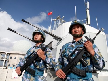 Soldiers of China's People's Liberation Army (PLA) Navy stand guard in the Spratly Islands, known in China as the Nansha Islands, February 10, 2016