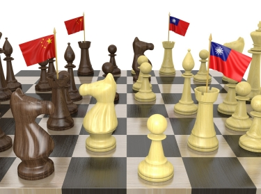 China and Taiwan flags on a chess board, photo by Kagenmi/Getty Images