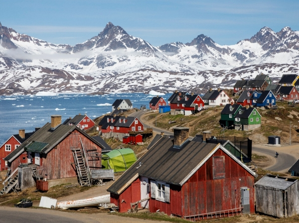 Snow-covered mountains rise above the harbor in Tasiilaq, Greenland, June 15, 2018, photo by Lucas Jackson/Reuters