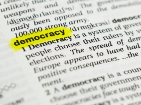 """Detail of the english word """"democracy""""  highlighted and its definition from the dictionary, photo by Lobro78/Getty Images"""