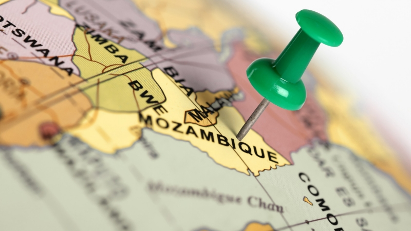 Mozambique on a map with a green pin, photo by Mark Rubens/Adobe Stock