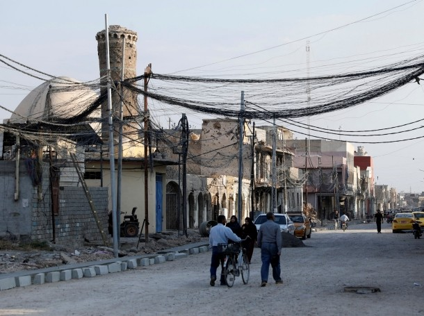 People walk on the street, where Islamic State leader Abu Bakr al-Baghdadi declared his caliphate back in 2014, in the old city of Mosul, Iraq, October 27, 2019, photo by Abdullah Rashid/Reuters