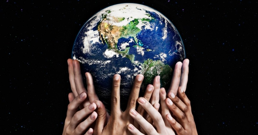 Hands holding up a globe, photo by RapidEye/Getty Images