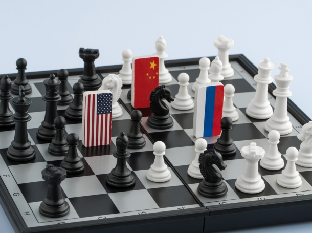 Flags of United States, Russia, and China on a chess board, photo by Albert_Karimov/Getty Images