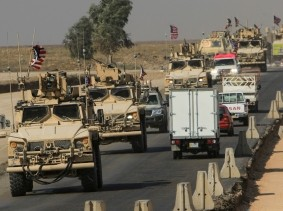 A convoy of U.S. vehicles after withdrawing from northern Syria, on the outskirts of Dohuk, Iraq, October 21, 2019, photo by Ari Jalal/Reuters