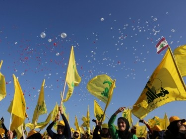 Supporters of Lebanon's Hezbollah leader Sayyed Hassan Nasrallah wave Hezbollah and Lebanese flags at a rally marking the 10th anniversary of the end of Hezbollah's 2006 war with Israel, in Bint Jbeil, Lebanon August 13, 2016, photo by AZIZ TAHER/Reuters