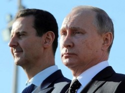 Russian President Vladimir Putin (R) and Syrian President Bashar al-Assad visit the Hmeymim air base in Latakia Province, Syria, December 11, 2017, photo by Mikhail Klimentyev/Sputnik Photo Agency/Reuters