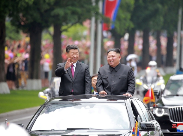 North Korean leader Kim Jong Un welcomes Chinese President Xi Jinping at the Pyongyang International Airport in Pyongyang, North Korea, in this undated photo released on June 21, 2019, photo by KCNA/Reuters