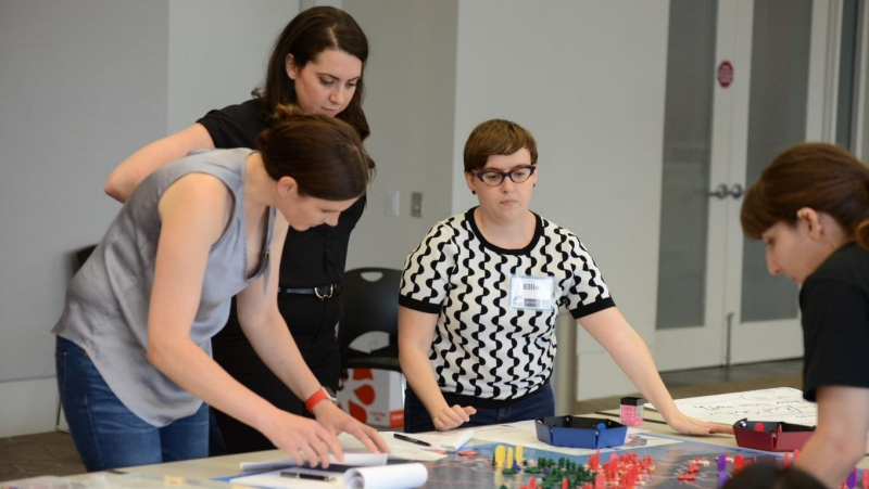 Becca Wasser with her RAND colleagues, during a wargame they designed for teen girls and young women, photo by Dori Walker/RAND Corporation
