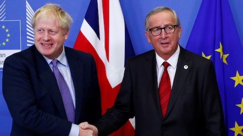 European Commission President Jean-Claude Juncker and Britain's Prime Minister Boris Johnson shake hands during a news conference after agreeing on the Brexit deal, Brussels, Belgium October 17, 2019, photo by Francois Lenoir/Reuters