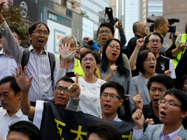 Pro-democratic winning candidates gather outside the campus of the Polytechnic University (PolyU) in Hong Kong, China, November 25, 2019, photo by Adnan Abidi/Reuters